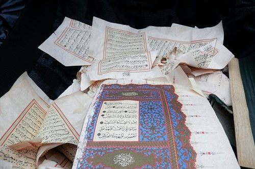 Image result for muslim tearing pages of quran